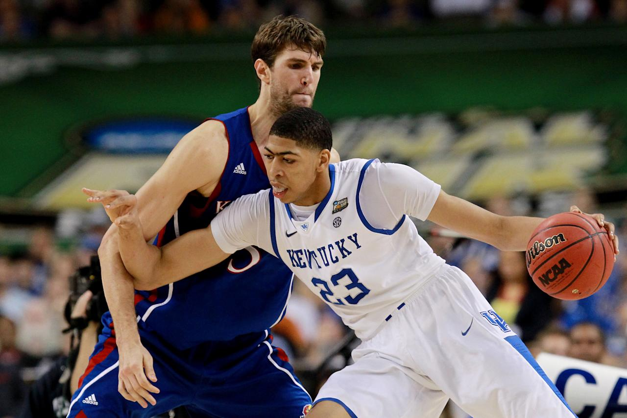 Anthony Davis #23 of the Kentucky Wildcats drives on Jeff Withey #5 of the Kansas Jayhawks in the second half in the National Championship Game of the 2012 NCAA Division I Men's Basketball Tournament at the Mercedes-Benz Superdome on April 2, 2012 in New Orleans, Louisiana. (Photo by Ronald Martinez/Getty Images)