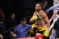 Vasiliy Lomachenko, of Ukraine, celebrates after defeating Masayoshi Nakatani, of Japan, by technical knockout during a lightweight bout Saturday, June 26, 2021, in Las Vegas. (AP Photo/John Locher)