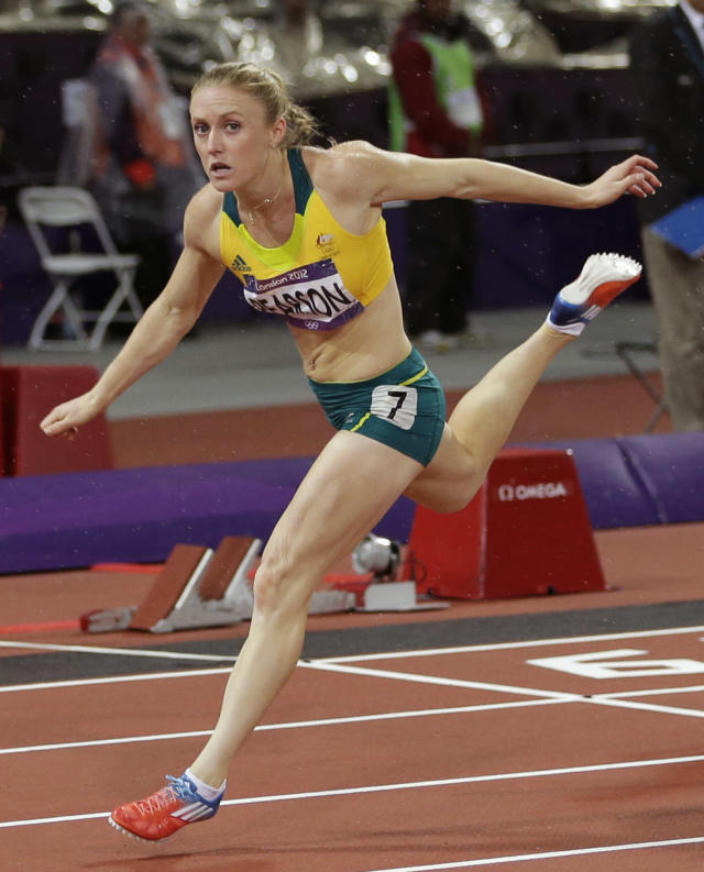 Australia's Sally Pearson reacts as she crosses the finish line to win gold in the women's 100-meter hurdles final during the athletics in the Olympic Stadium at the 2012 Summer Olympics, London, Tuesday, Aug. 7, 2012. (AP Photo/David J. Phillip )