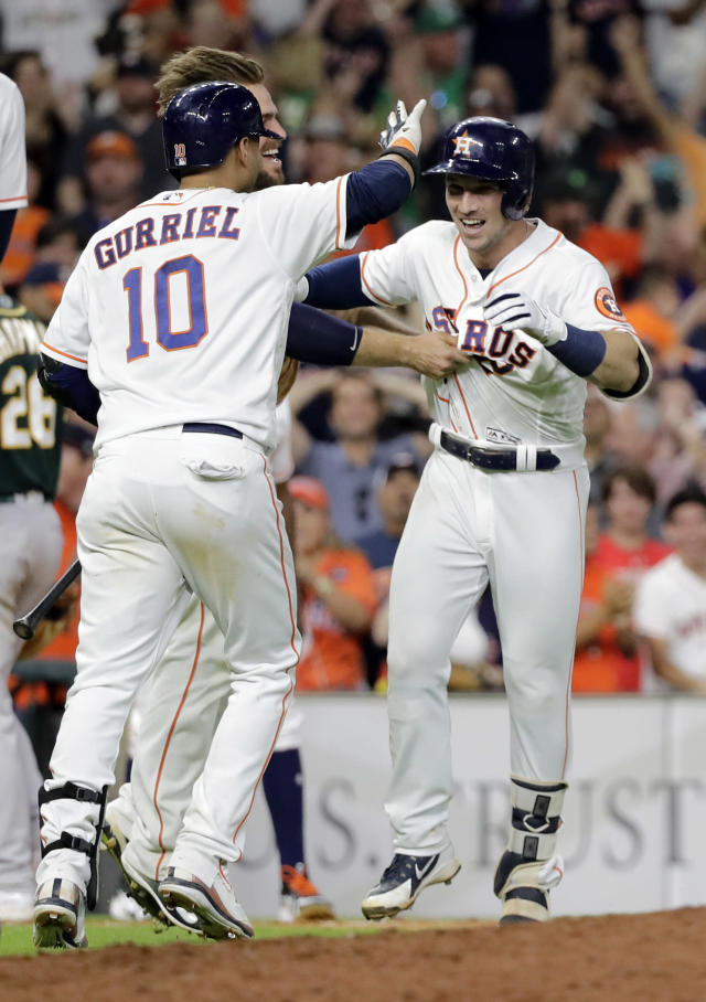 Houston Astros' Alex Bregman (2) celebrates with teammates after a baseball game against the Oakland Athletics on Tuesday, July 10, 2018, in Houston. The Astros won 6-5 in 11 innings. (AP Photo/David J. Phillip)