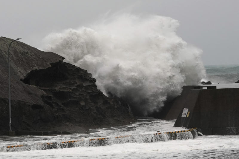 Surging waves hitting against the breakwater as Typhoon Hagibis approaches at a port in Kumano, Mie Prefecture, Japan Saturday, Oct. 12, 2019. (AP Photo/Toru Hanai)