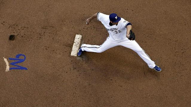 Milwaukee Brewers starting pitcher Matt Garza throws during the first inning of a baseball game against the Minnesota Twins, Monday, June 2, 2014, in Milwaukee. (AP Photo/Morry Gash)
