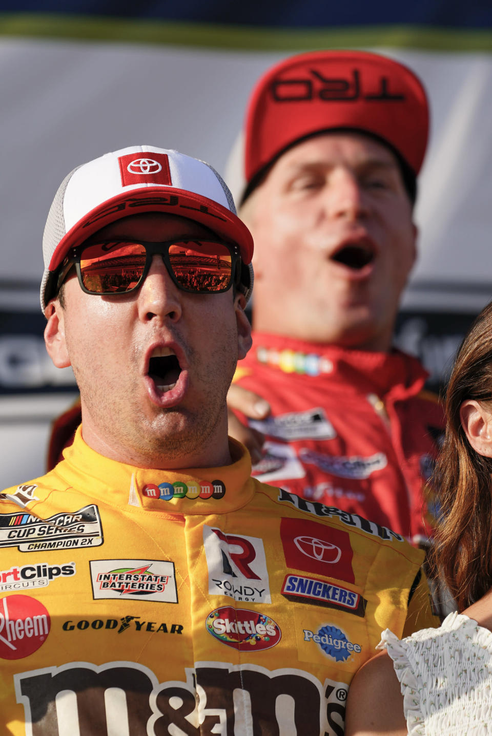 Kyle Busch, left, celebrates with teammates after winning a NASCAR Cup Series auto race at Pocono Raceway, Sunday, June 27, 2021, in Long Pond, Pa. (AP Photo/Matt Slocum)