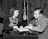 """<p>During a dress rehearsal for the CBS Radio program """"Theater of Romance,"""" Shirley Temple consults producer Charles Vanda. </p>"""