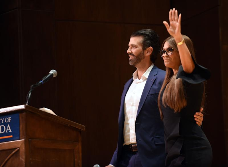 Donald Trump Jr. hugs his girlfriend, Kimberly Guilfoyle, before speaking at the University of Florida on Oct. 10. (Photo: SOPA Images via Getty Images)
