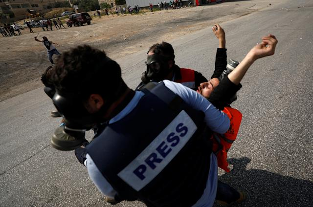 <p>A wounded Palestinian is evacuated during a protest marking the 70th anniversary of Nakba, near the Jewish settlement of Beit El, near Ramallah, in the occupied West Bank, May 15, 2018. (Photo: Mohamad Torokman/Reuters) </p>
