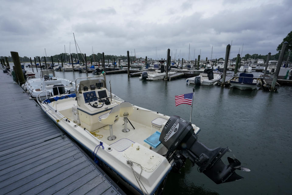 Storm clouds loom over boats docked at a marina in Branford, Conn., Sunday, Aug. 22, 2021 as Tropical Storm Henri affects the Atlantic coast. (AP Photo/Mary Altaffer)