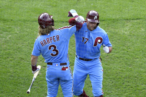Philadelphia Phillies' Rhys Hoskins, right, celebrates with Bryce Harper (3) after hitting a solo home run off Washington Nationals' Anibal Sanchez during the third inning of a baseball game, Thursday, Sept. 3, 2020, in Philadelphia. (AP Photo/Derik Hamilton)