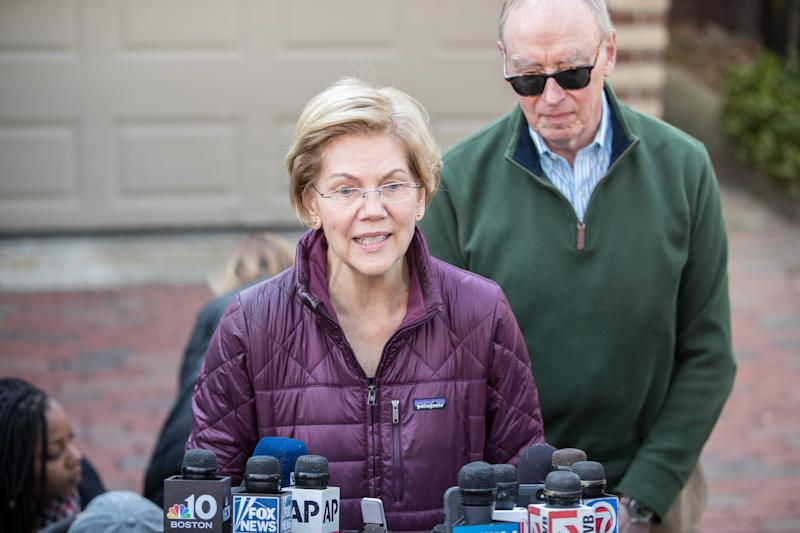 Sen. Elizabeth Warren (D-MA), with husband Bruce Mann, announces that she is dropping out of the presidential race during a media availability outside of her home on March 5, 2020 in Cambridge, Massachusetts. (Scott Eisen/Getty Images)