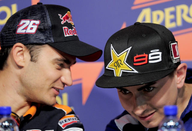 Yamaha Factory Racing's Spanish Jorge Lorenzo (R) and Repsol Honda Team Spanish Jorge Lorenzo attend a press conference at the Catalunya racetrack in Montmelo, near Barcelona, on May 31, 2012, on eve of the Catalunya Moto GP Grand Prix training sessions. AFP PHOTO / JOSEP LAGOJOSEP LAGO/AFP/GettyImages