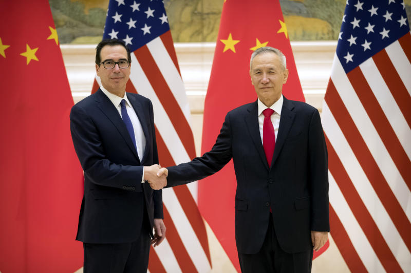 United States Finance Minister Stephen Munchin, left and Chinese Deputy Prime Minister and Trade Lead Liu, shake hands while posing for a photo before the opening of the trade talks at Beijing State Guest House Diaoyuti, Thursday, February 14, 2019. Photo / Mark Schifelfen, Pool)