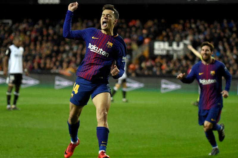 On target: Philippe Coutinho wheels away after scoring his first Barca goal: AFP/Getty Images