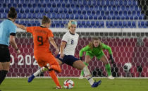 Netherlands' Vivianne Miedema, left, strikes the ball to score her side's 2nd goal during a women's quarterfinal soccer match against United States at the 2020 Summer Olympics, Friday, July 30, 2021, in Yokohama, Japan. (AP Photo/Kiichiro Sato)