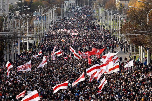 Opposition supporters parade through the streets during a rally to protest against the Belarus presidential election results in Minsk on October, 2020. (Photo: AFP via Getty Images)