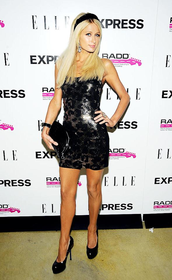 """Paris Hilton has been MIA for the past few weeks. Thankfully, she made a triumphant return to the party circuit in a stunning sequined mini, Yves St. Laurent pumps, and super cute headband. Frazer Harrison/<a href=""""http://www.gettyimages.com/"""" target=""""new"""">GettyImages.com</a> - July 29, 2009"""