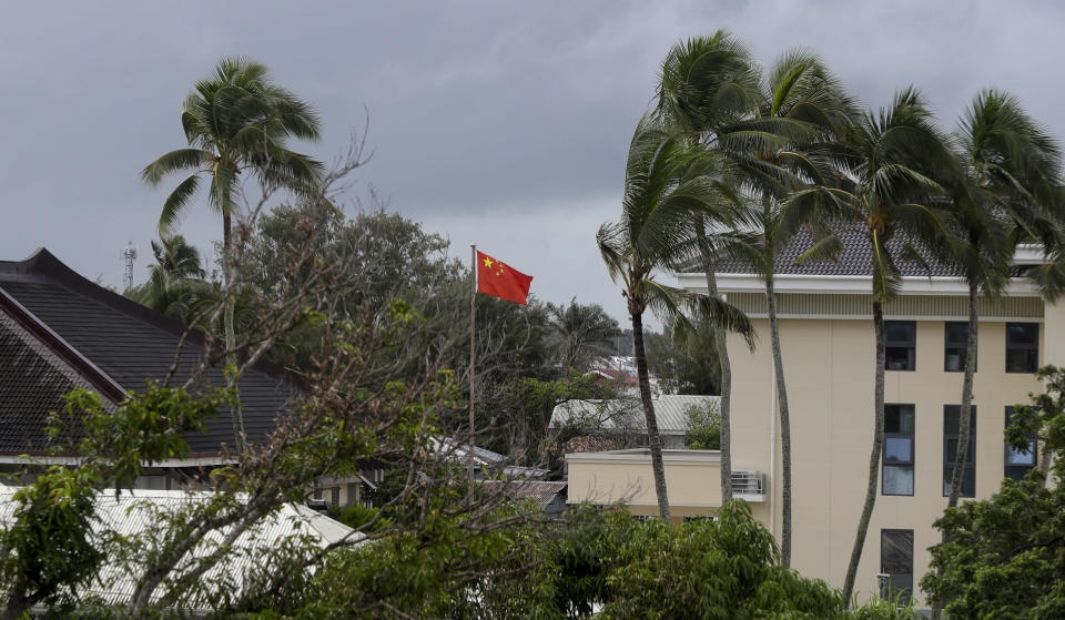 FILE - In this April 8, 2019, file photo, a Chinese flag flies outside the Chinese Embassy in Nuku'alofa, Tonga. The Sydney-based think tank Lowy Institute released its annual Pacific Aid Map, Wednesday, Sept. 29, 2021, saying China gave significantly less aid to the Pacific in recent years despite Beijing's diplomatic efforts to increase its influence in the region. (AP Photo/Mark Baker, File)