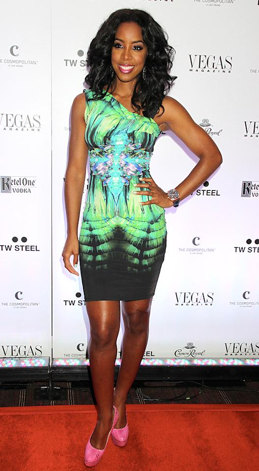 Kelly Rowland is currently gracing the cover of <i>VEGAS Magazine</i>, and to  celebrate the reveal, the former Destiny's Child member partied the  night away at Sin City's Cosmopolitan Resort & Casino in this  technicolor Roberto Cavalli dress and $1,500 metallic Charlotte Olympia pumps. Now that's what we call 2 Hot 2 Handle! (6/9/2012)