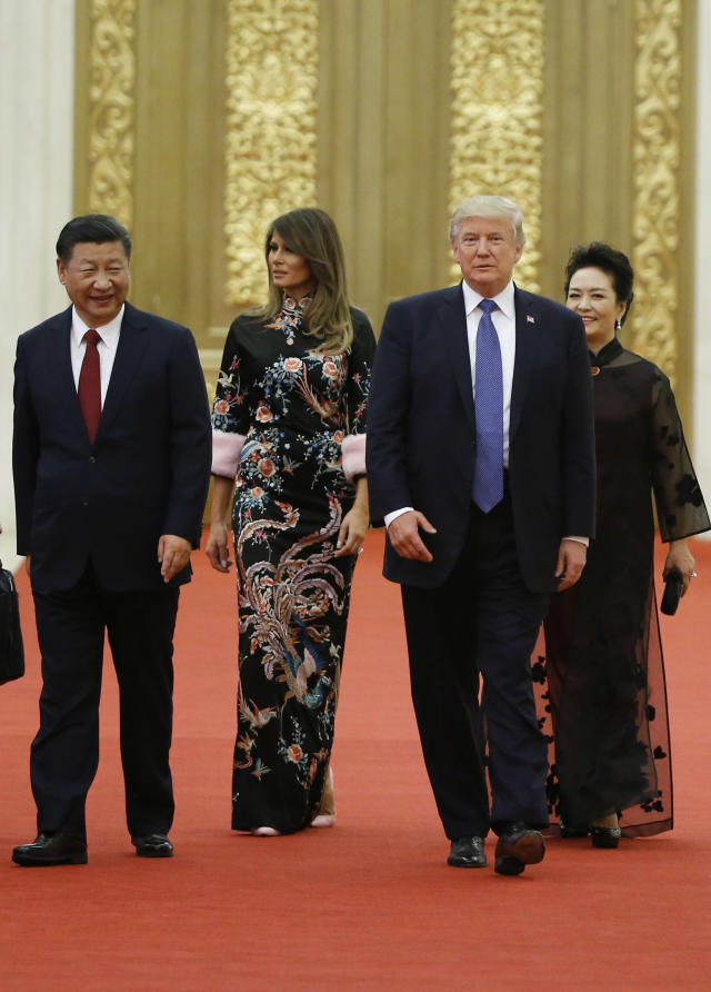 President Trump and first lady Melania Trump arrive for the state dinner with Chinese President Xi Jinping and China's first lady, Peng Liyuan, at the Great Hall of the People in Beijing on Nov. 9. (Photo: Thomas Peter/Pool Photo via AP)
