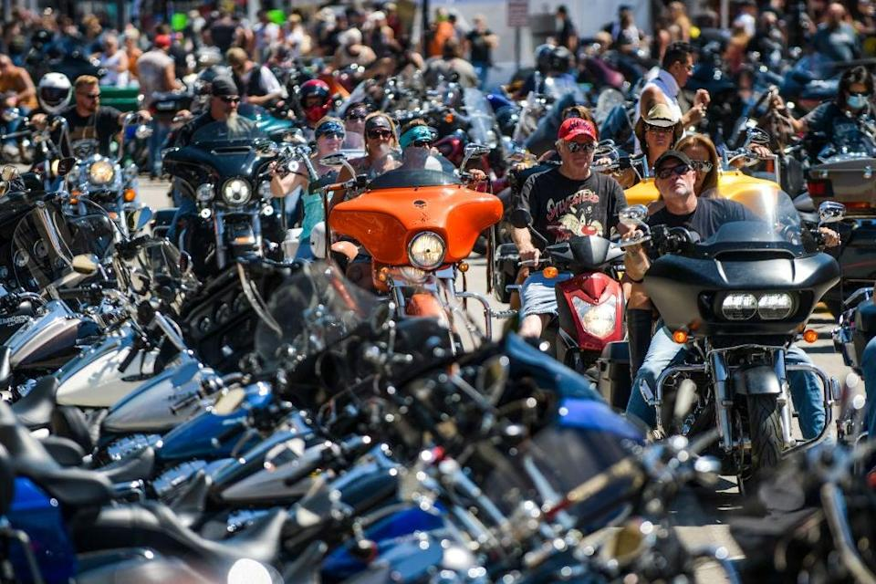 Motorcyclists ride down Main Street during the 80th Annual Sturgis Motorcycle Rally on 7 August 2020 in Sturgis, South Dakota (Getty)