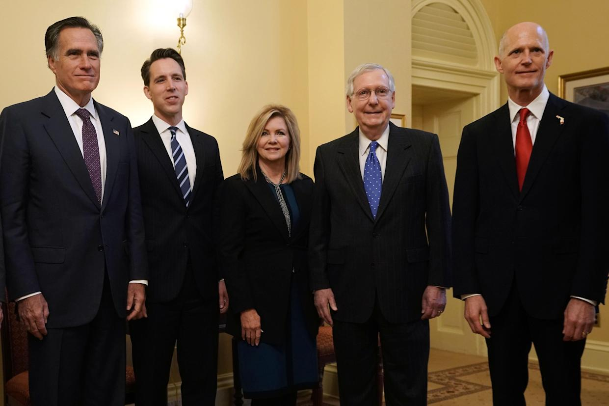 "<span class=""s1"">Although the race has not yet been called, Rick Scott of Florida (right) posed for a photo Thursday in Washington with Senate Majority Leader Mitch McConnell (second from right) and, from left, Republican Sens.-elect Mitt Romney of Utah, Josh Hawley of Missouri and Marsha Blackburn of Tennessee. (Photo: Alex Wong/Getty Images)</span>"