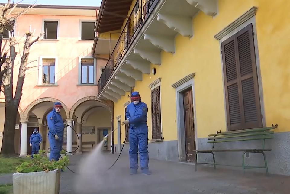 LOMBARDY, ITALY  APRIL 7, 2020: Russian military sanitary workers carry out a full disinfection and sanitising of indoor premises and the adjacent area of the San Giuseppe care home in Gorlago, Lombardy, northern Italy. Russia has sent military virologists, epidemiologists and CBRN specialists to Italy to help battle the pandemic of the novel coronavirus (COVID-19). Russian Defence Ministry/TASS (Photo by Russian Defence Ministry\TASS via Getty Images)