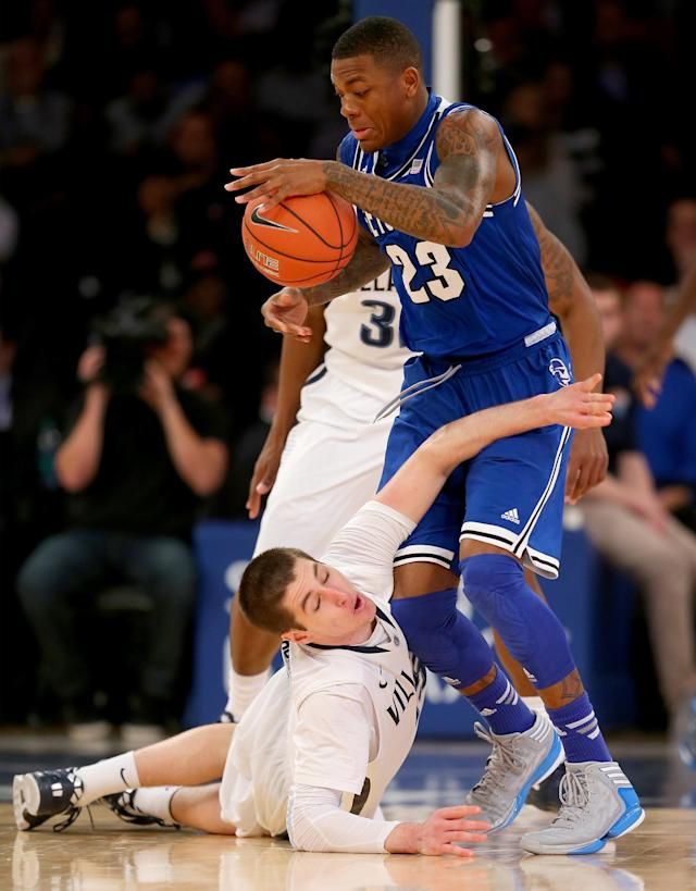 NEW YORK, NY - MARCH 13: Fuquan Edwin #23 of the Seton Hall Pirates grabs the loose ball as Ryan Arcidiacono #15 of the Villanova Wildcats scrambles during the quarterfinals of the Big East Basketball Tournament at Madison Square Garden on March 13, 2014 in New York City.Seton Hall Pirates defeated the Villanova Wildcats 64-63. (Photo by Elsa/Getty Images)