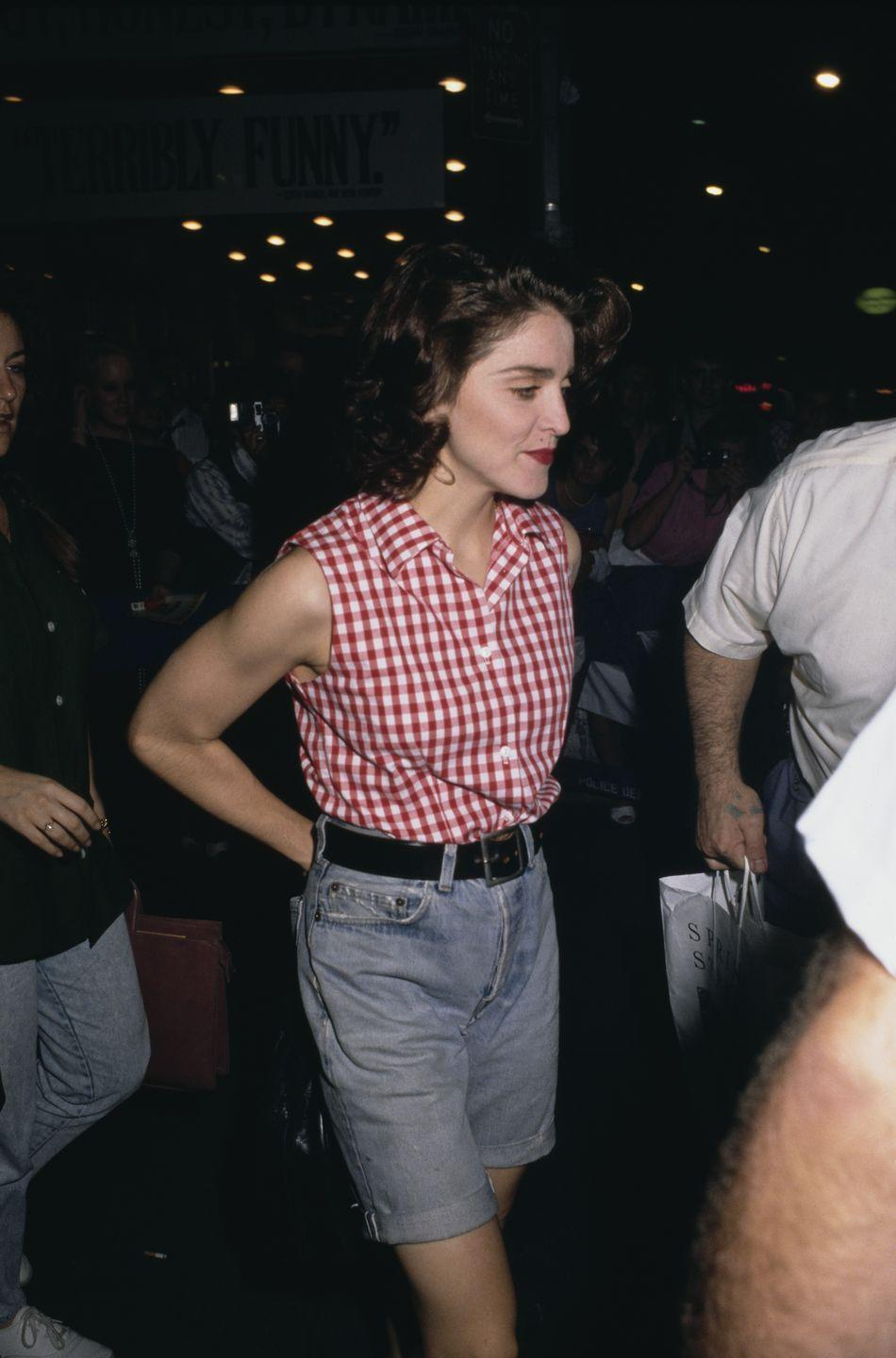 <p>Madonna opted for a pair of denim Bermuda shorts as she left the theater during her performance in Broadway's <em>Speed-the-Plow</em>. The outfit was considerably toned down for the singer. </p>
