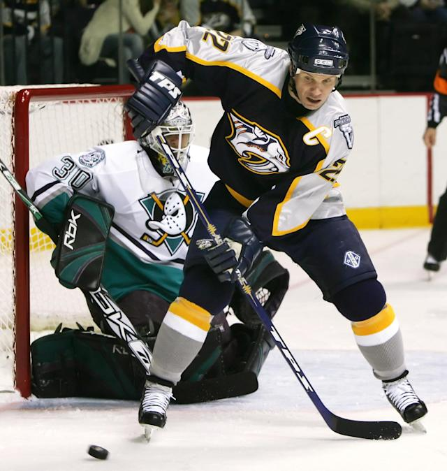 Anaheim Mighty Ducks goalie Ilya Bryzgalov (30) of Russia follows the puck as Nashville Predators center Greg Johnson (22) takes a pass in first period on NHL hockey action on Sunday, Jan. 1, 2006, in Nashville, Tenn. (AP Photo/Mark Humphrey)