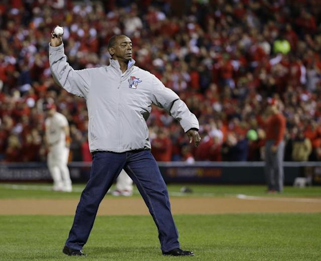 Former St. Louis Cardinals' Willie McGee throws out the ceremonial first pitch before Game 3 of baseball's World Series between the Boston Red Sox and the St. Louis Cardinals Saturday, Oct. 26, 2013, in St. Louis. (AP Photo/Matt Slocum)