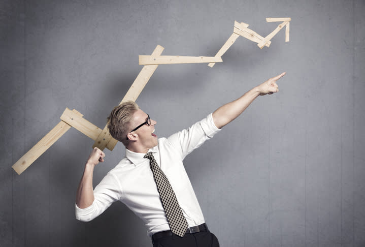 A businessman pointing up.