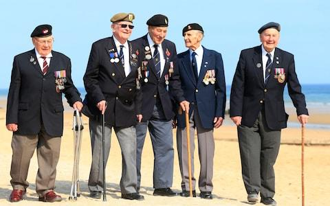 Len Fox, second from the left, sang part of We'll Meet Again at the Arromanches service - Credit: Jonathan Brady/PA