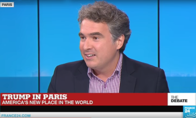 Lex Paulson is interviewed on France 24 TV during President Trump's visit in Paris in July. (YouTube)