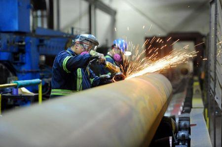 FILE PHOTO: Workers are seen at Bri-Steel Manufacturing, a manufacturer and distributer of large diameter seamless steel pipes, in Edmonton, Alberta, Canada June 21, 2018. REUTERS/Candace Elliott/File Photo