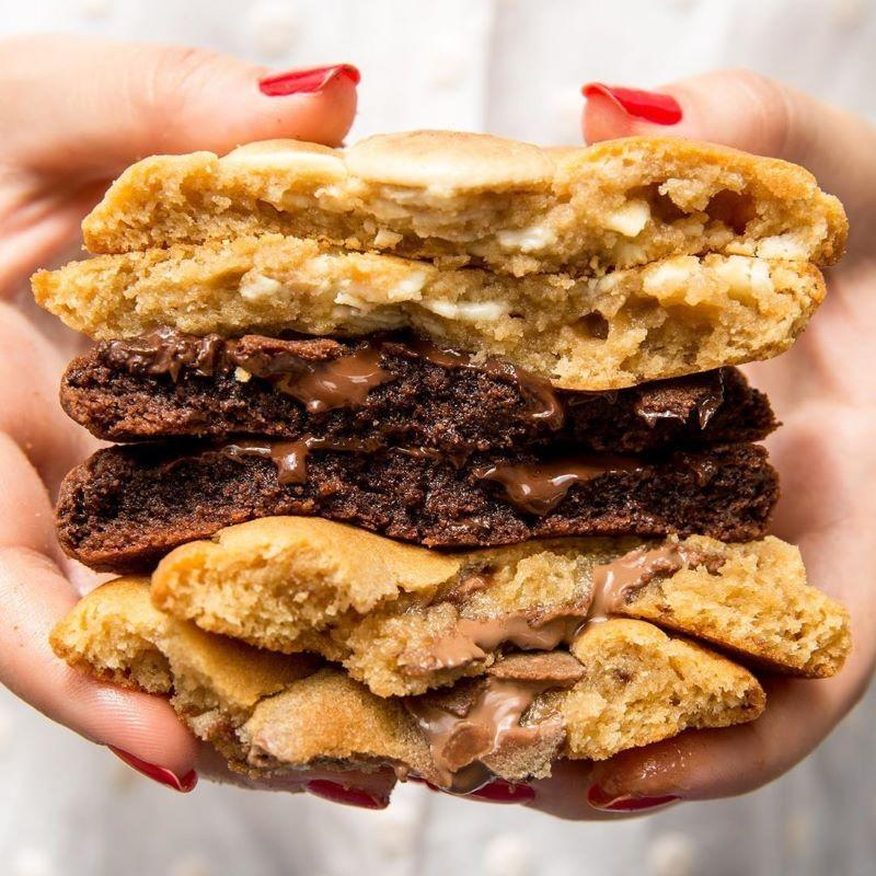 Person holding a stack of Ben's Cookies