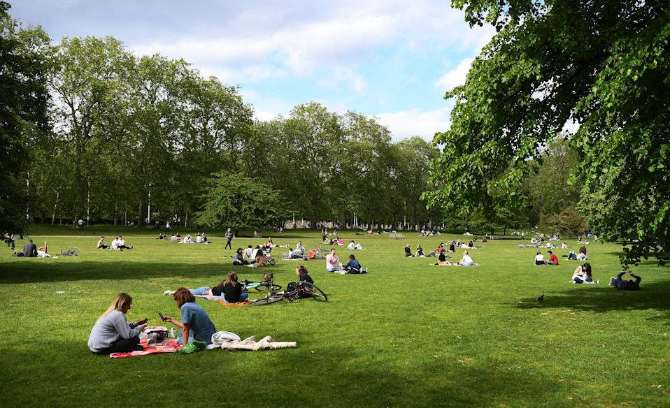 LONDON, ENGLAND- MAY 16: Members of the public relax in St James's Park on May 16, 2020 in London, England . The prime minister announced the general contours of a phased exit from the current lockdown, adopted nearly two months ago in an effort curb the spread of Covid-19. (Photo by Alex Davidson/Getty Images)