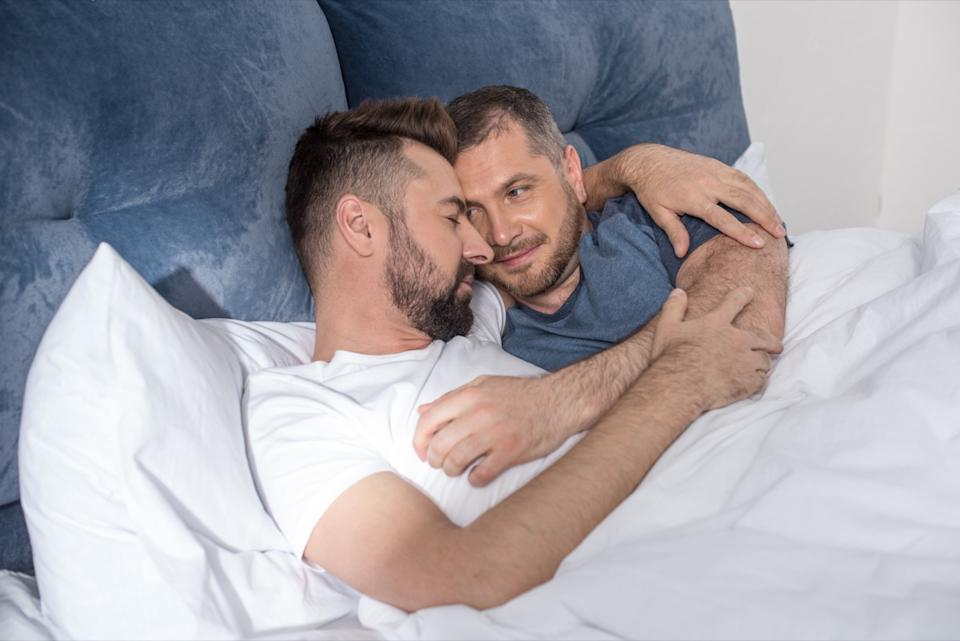 middle aged gay couple cuddling