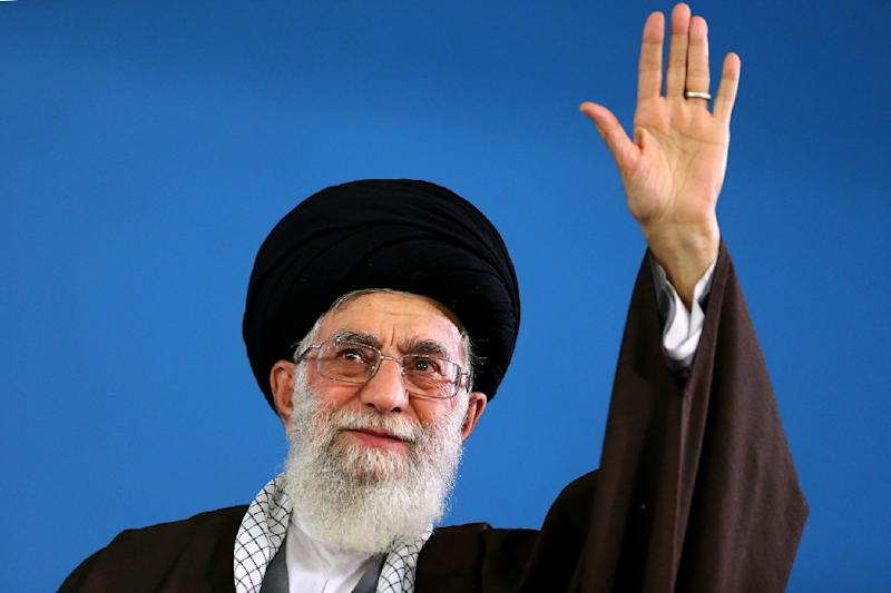 A picture released on May 6, 2015 by the official website of the Centre for Preserving and Publishing the Works of Iran's supreme leader Ayatollah Ali Khamenei, shows him waving to the crowd on May 6, 2015 in Tehran