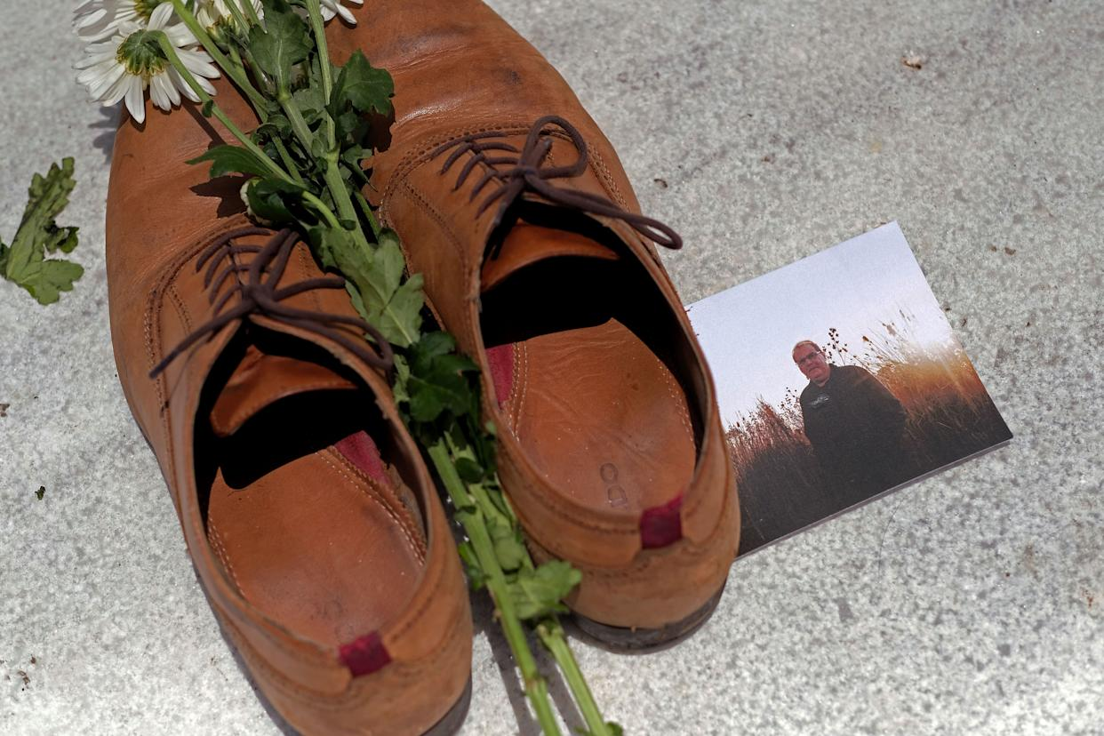 A photo of Luis Manuel Vazquez among the shoes at the Capitol in San Juan. (Photo: RICARDO ARDUENGO / Getty Images)