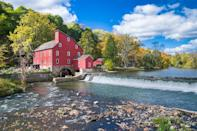 <p>The historic, bright red mill in Clinton, New Jersey is a bright spot on the Raritan River. </p>
