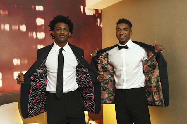 <p>De'Aaron Fox, left, and Malik Monk, right, wear their custom-lined JF J. Ferrar suits available only at JCPenney, as they prepare to head off to the Draft, New York, N.Y., Thursday, June 22, 2017. (Stuart Ramson/AP Images for JCPenney) </p>