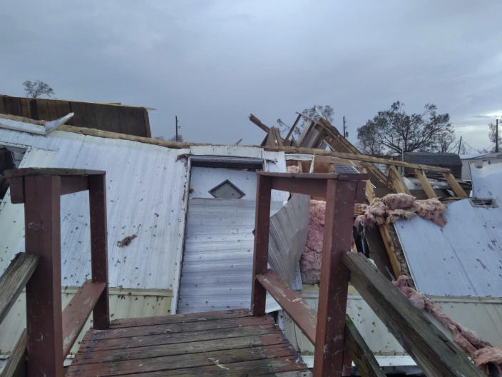 This photo provided by Katlyn Smith shows damage to the Jesse James trailer park on country club Road in Lake Charles, La., from Hurricane Laura on Friday, Aug. 28, 2020. The destructive storm surge has receded, and the cleanup has begun from Hurricane Laura. But officials along this shattered stretch of southwestern Louisiana are warning returning residents they will face weeks without power or water amid the hot, stifling days of late summer. (Katlyn Smith via AP)