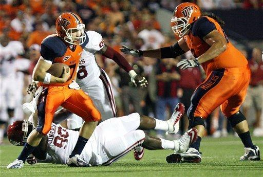 Oklahoma defensive end David King, bottom, sacks UTEP quarteraback Nick Lamaison during an NCAA college football game at the Sun Bowl, Saturday, Sept., 1, 2012 in El Paso, Texas. (AP Photo/Mark Lambie)