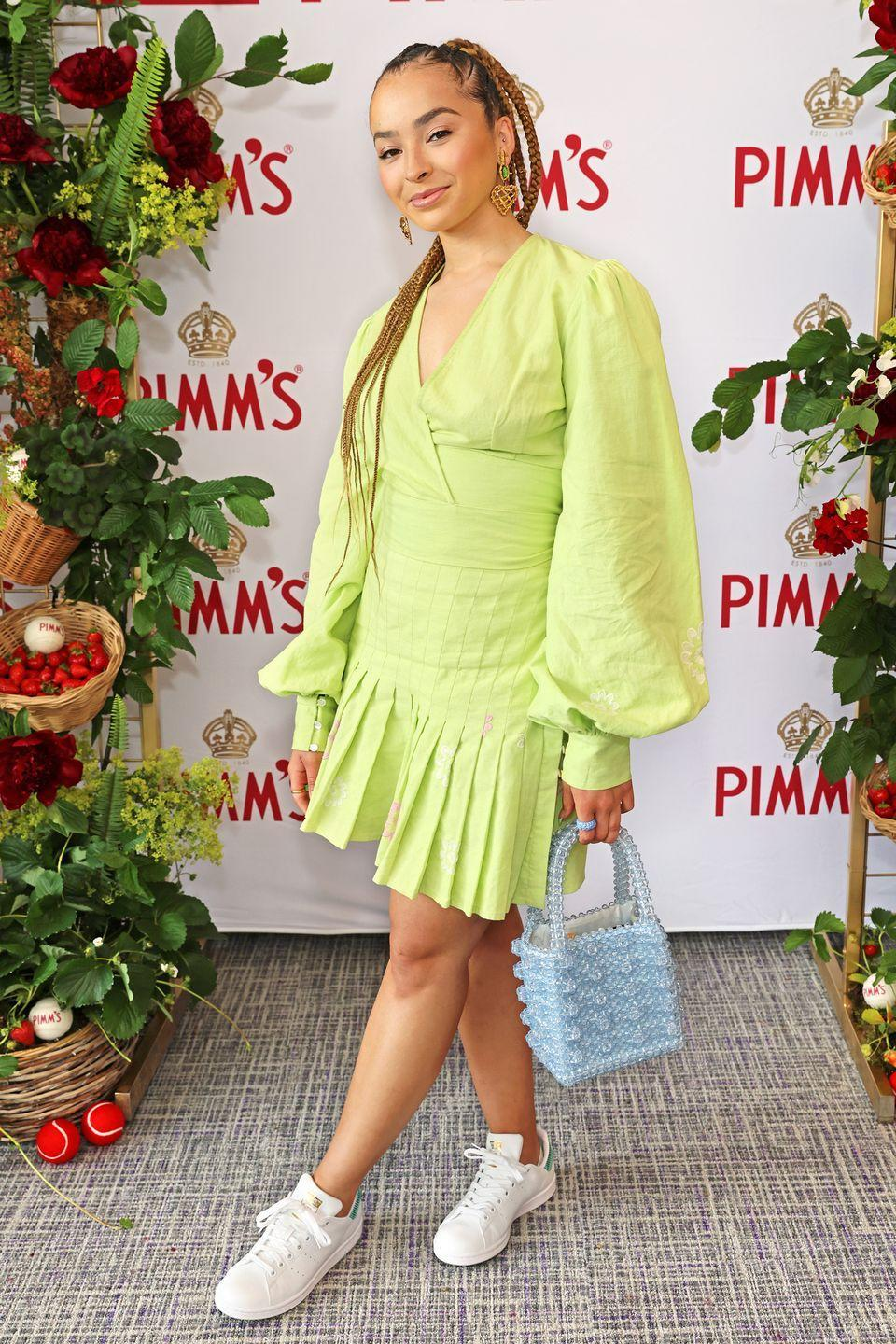 <p>Ella Eyre accessorised her green Cinta the Label green two-piece with a beaded Shrimps bag. </p>