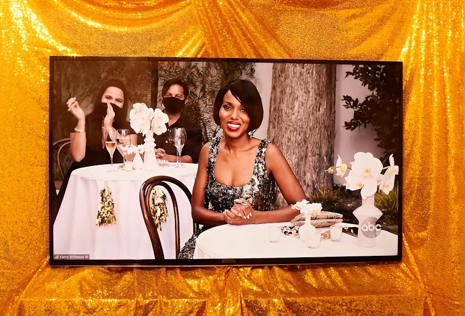 """<h2>Kerry Washington in Oscar de la Renta</h2>But of course, Kerry Washington didn't stop at just one look for the night. For the NYE portion of the <em>Little Fires Everywhere</em> backyard party, Washington swapped out her floral gown for another ODLR original, this time, a black-and-gold number made for an end-of-2020 celebration.<span class=""""copyright"""">Photographed by Joel Arbaje for Refinery29.</span>"""