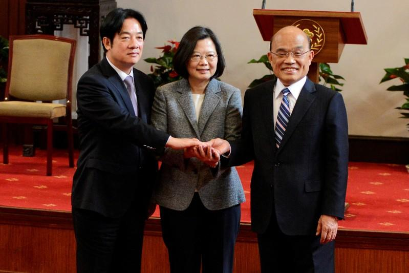 FILE PHOTO: Former premier William Lai, Taiwan President Tsai Ing-wen and new premier Su Tseng-chang join hands after a news conference in Taipei