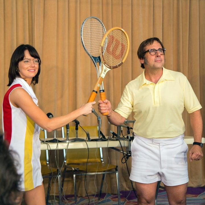 Billie Jean king and Bobby Riggs posing with their tennis rackets touching in Battle of the Sexes