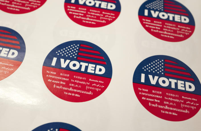 "FILE - In this Tuesday, June 5, 2018, file photo, ""I Voted"" stickers wait for voters at a polling station inside the library at Robert F. Kennedy Elementary School in Los Angeles. Californians start voting Monday, Feb. 3, 2020, in a high-profile Democratic presidential primary that has no clear front-runner. The March 3 primary was moved up from its usual June date so Californians might have more of a say in the outcome of the primary and the decision about the eventual Democratic nominee. (AP Photo/Richard Vogel, File)"