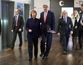 U.S. Secretary of State John Kerry (R) walks with European Union foreign policy chief Catherine Ashton before their meeting with Iranian Foreign Minister Mohammad Javad Zarif (not pictured) in Geneva, November 8, 2013. REUTERS/Jason Reed