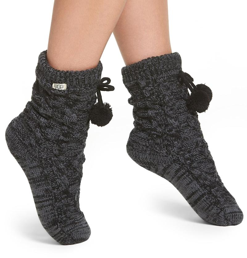 Fleece-lined, chunky cable-knit, pom-pommed Ugg slipper-socks. Need we say more? (Photo: Nordstrom)