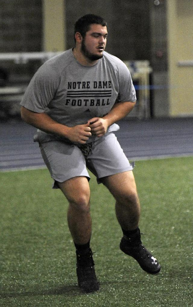 Notre Dame lineman Zack Martin runs a drill during Notre Dame's pro day for NFL football scouts Thursday, March 20, 2014, in South Bend, Ind. (AP Photo/Joe Raymond)